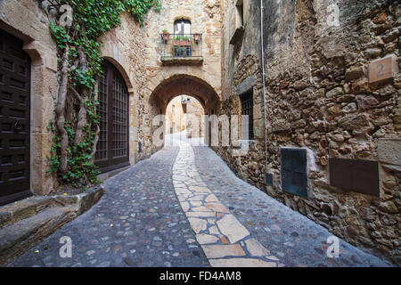 Passageway in the old town of Pals in Girona, Catalonia. - Stock Photo