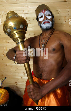 Celebration of Diwali festival in an ISKCON temple. Devotee impersonating god Hanuman - Stock Photo