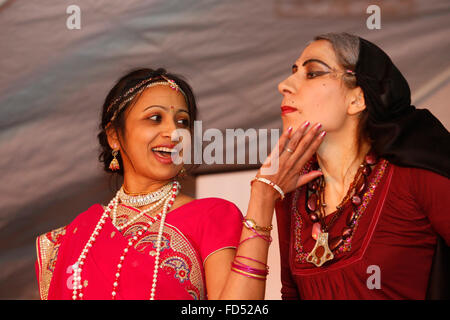 Celebration of Diwali festival in an ISKCON temple. Devotees impersonating Kaikeyi and Mantara in the Ramayana - Stock Photo