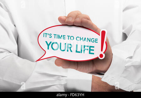 Image of a man hand holding speech bubble with the text it is time to change your life, white shirt. Conceptual - Stock Photo