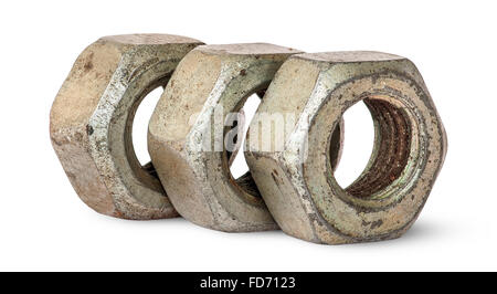 Three old rusty nuts in a row rotated isolated on white background - Stock Photo