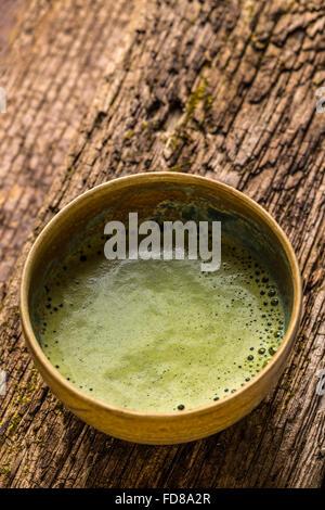Matcha tea serving in matcha bowl - Stock Photo