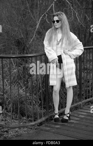 Beautiful young model on set relaxing in her gown between shoots. January 2016 - Stock Photo