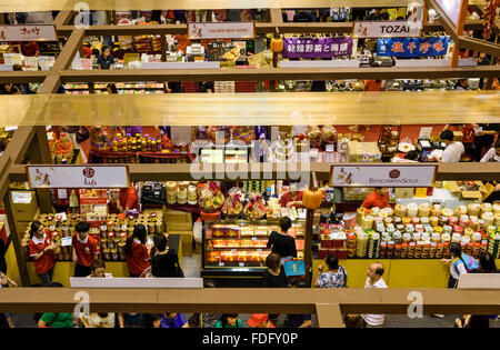 Luna New Year festive gift stalls in the indoor Takashimaya Square at Ngee Ann City Shopping Mall, Orchard Rd, Singapore - Stock Photo