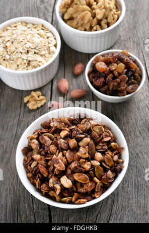 Chocolate muesli and ingredients on wooden background, top view - Stock Photo