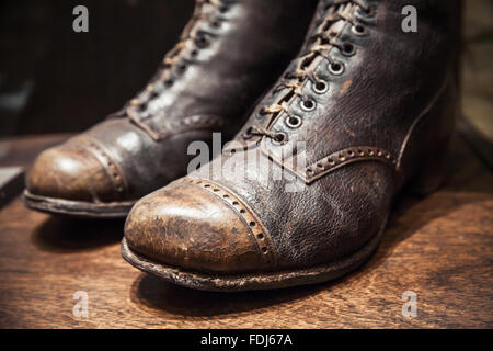 Old used shoes made of genuine leather, close up photo with selective focus - Stock Photo