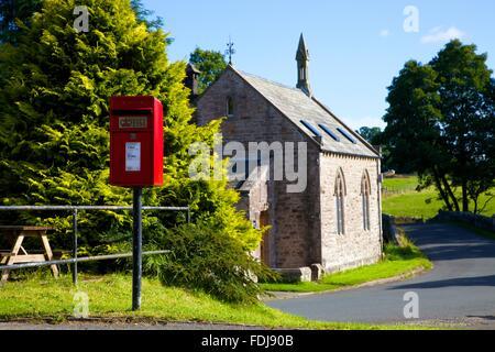 Red post Lamp box on a pole. Blencow, Cumbria, England, United Kingdom. - Stock Photo