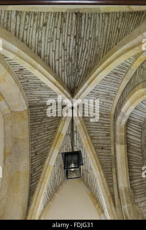 The vaulted ceiling with part of the original stonework from the medieval abbey, in the Exit Lobby at Buckland Abbey, - Stock Photo