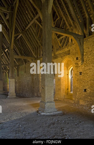 Inside the mid-thirteenth century monastic Great Coxwell Barn near Faringdon in Oxfordshire. Cotswold stone piers - Stock Photo