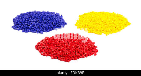 Colourful plastic granules on a white background - Stock Photo