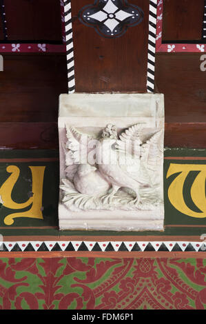 Stone corbel carved with a bird in the Dining Room at Knightshayes Court, Devon. - Stock Photo