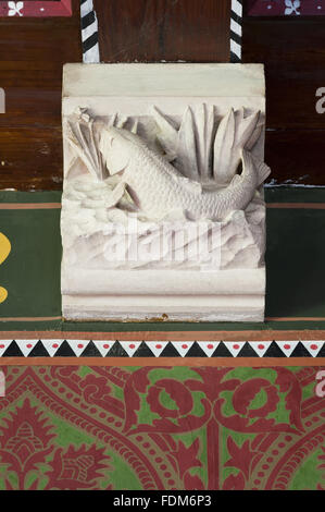 Stone corbel carved with a fish in the Dining Room at Knightshayes Court, Devon. - Stock Photo