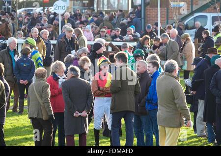 people standing in paddock at fakenham races, north norfolk, england - Stock Photo
