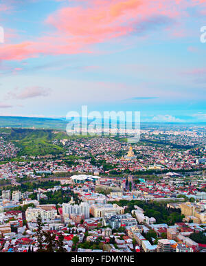 View from above on Tbilisi city at sunset.  Georgian republic - Stock Photo
