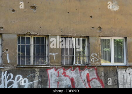 Damage from a bullet scarred apartment building in Sarajevo provides a reminder of the Bosnian War - Stock Photo