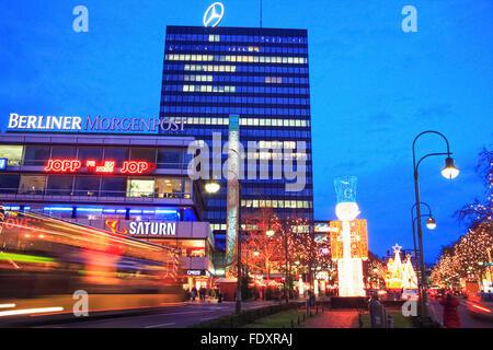 Europa-Center building complex and traffic trails in Breitscheidplatz, Berlin, Germany - Stock Photo