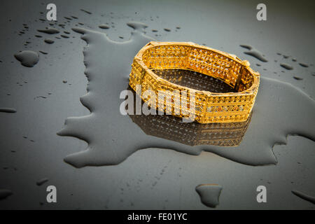 Jewelry, gold ornament, gold bangles, gold bracelets, Indian jewelry design, pair of bangles, fashion accessories, - Stock Photo