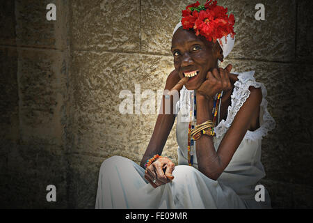 Portrait of the old Cuban african woman smoking a cigar in the street in Havana, Cuba - Stock Photo