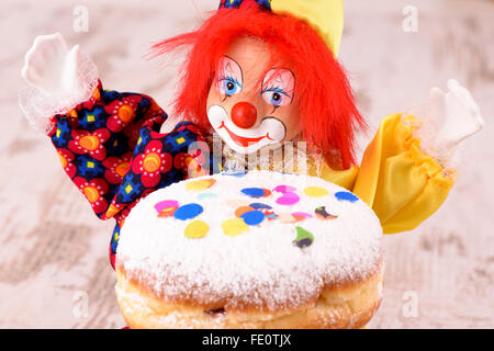 doughnut with clown at carnival - Stock Photo
