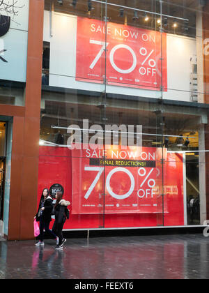 Shop displays a sale promotion in Lord Street Liverpool during the January Sales. - Stock Photo