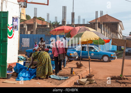 A roadside stall selling seafood in the Guinea Bissau capital city of Bissau - Stock Photo