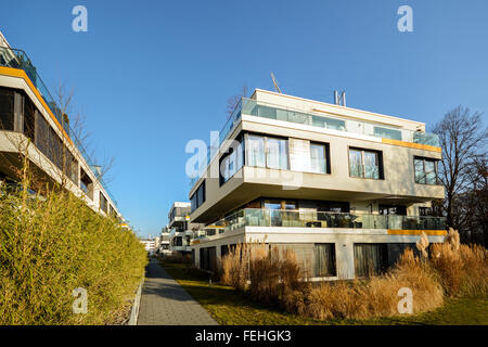 Modern residential buildings with outdoor facilities, Facade of new low-energy apartment houses - Stock Photo