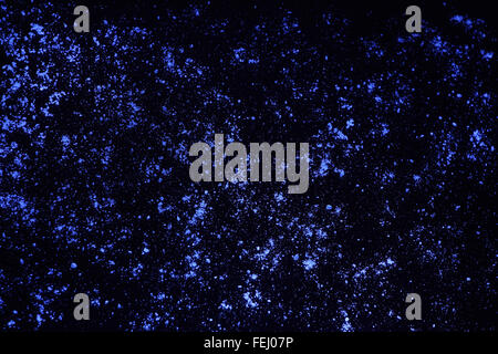 Glowing blue dots on black, abstract background - Stock Photo