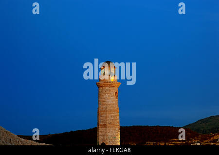Crete, port Rethymno, old lighthouse at night in the Venetian harbour - Stock Photo