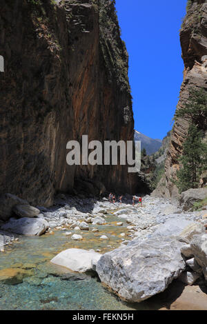 Crete, scenery in the Samaria gulch, traveller run in the brook bed - Stock Photo