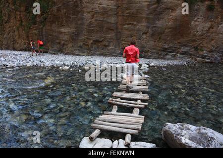 Crete, scenery in the Samaria gulch, wooden bridge about the brook - Stock Photo