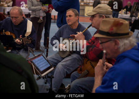 Local musicians playing at an indoor market at Williams College in Williamstown, Massachusetts. - Stock Photo