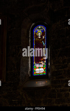 Stained glass in a Italian church - Stock Photo