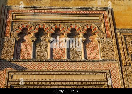 Moorish doorway arches elaborately inscribed stonework of the mezquita Great Mosque, Cordoba, Spain - Stock Photo