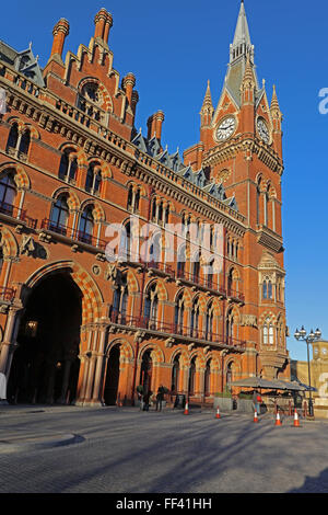 A side view of Saint Pancras Railway station with its huge clock tower and multiple windows facing the road - Stock Photo