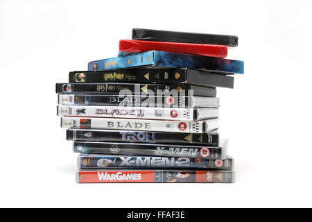 A Pile Of DVDs Harry Potter, Blade Trilogy, Tron, X-Men And X-Men 2 And Wargames - Stock Photo