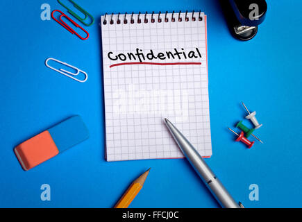 Confidential word on notebook page - Stock Photo