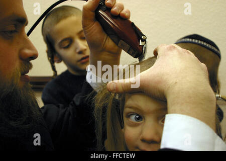 In Stamford Hill, London, United Kingdom on the 3rd birthday of a Orthodox Jewish boy he has his first ever hair - Stock Photo