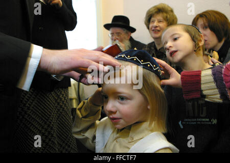 In Stamford Hill, London, United Kingdom, on the 3rd birthday of a Orthodox Jewish boy he has his first ever hair - Stock Photo