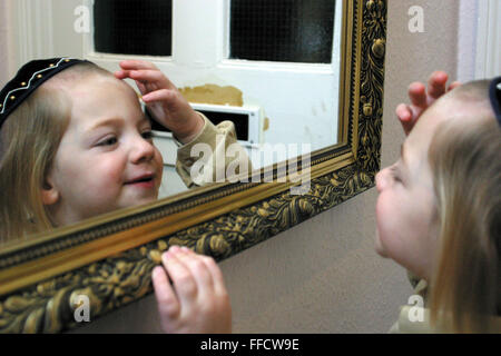 On the 3rd birthday of an Orthodox Jewish boy he has his first ever hair cut in a ceremony called an Upsherin leaving - Stock Photo