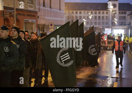 Worms, Germany. 13th February 2016. The right wing protesters march with flags from the 'Der III. Weg' through Worms. - Stock Photo