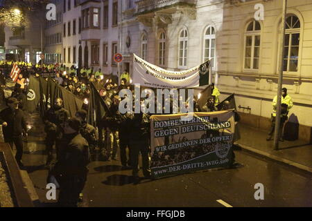 Worms, Germany. 13th Feb, 2016. The right wing protesters march through Worms. The banner reads 'Terror bombing - Stock Photo