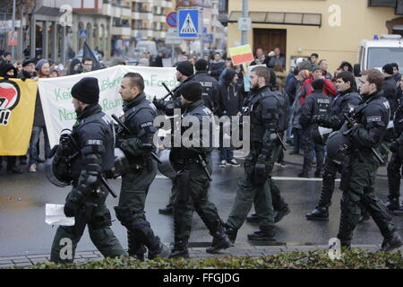 Worms, Germany. 13th Feb, 2016. Riot police officers march past the counter demonstration, ahead of the march. Around - Stock Photo