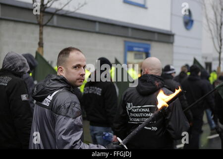 Worms, Germany. 13th Feb, 2016. One of the right-wing protesters carries a burning torch. Around 80 members of the - Stock Photo
