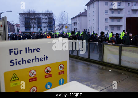 Worms, Germany. 13th Feb, 2016. The right wing protesters march past a petrol station with burning torches. The - Stock Photo