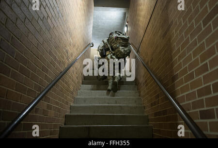 Airman 1st Class Kaitlyn Evans, an 11th Security Forces Squadron patrolman, walks to her dorm room prior to night - Stock Photo