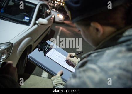 Airman 1st Class Kaitlyn Evans prepares a vehicle parking ticket during her night-shift duty at Joint Base Andrews, - Stock Photo