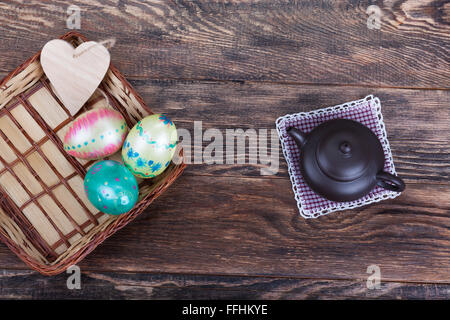 Easter festive decorations for meal on wooden background - Stock Photo