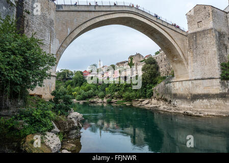 most famous landmark in Mostar city - Stari Most (Old Bridge) over Neretva river, Bosnia and Herzegovina - Stock Photo