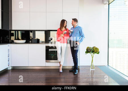 Couple in apartment having a coffee break - Stock Photo