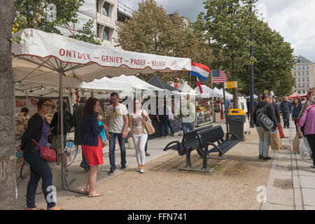 Street Market in Ghent old town, Belgium, Europe with food market stalls, shoppers and tourists - Stock Photo
